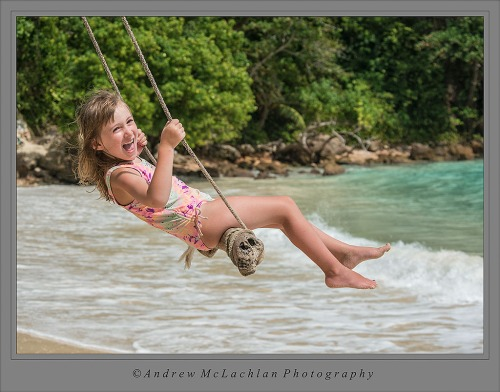Ava on swing at Boston Bay, Jamaica